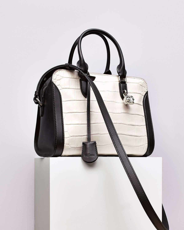 TrulyNM: Alexander McQueen Crocodile-Embossed Medium Padlock tote bag in black and white.