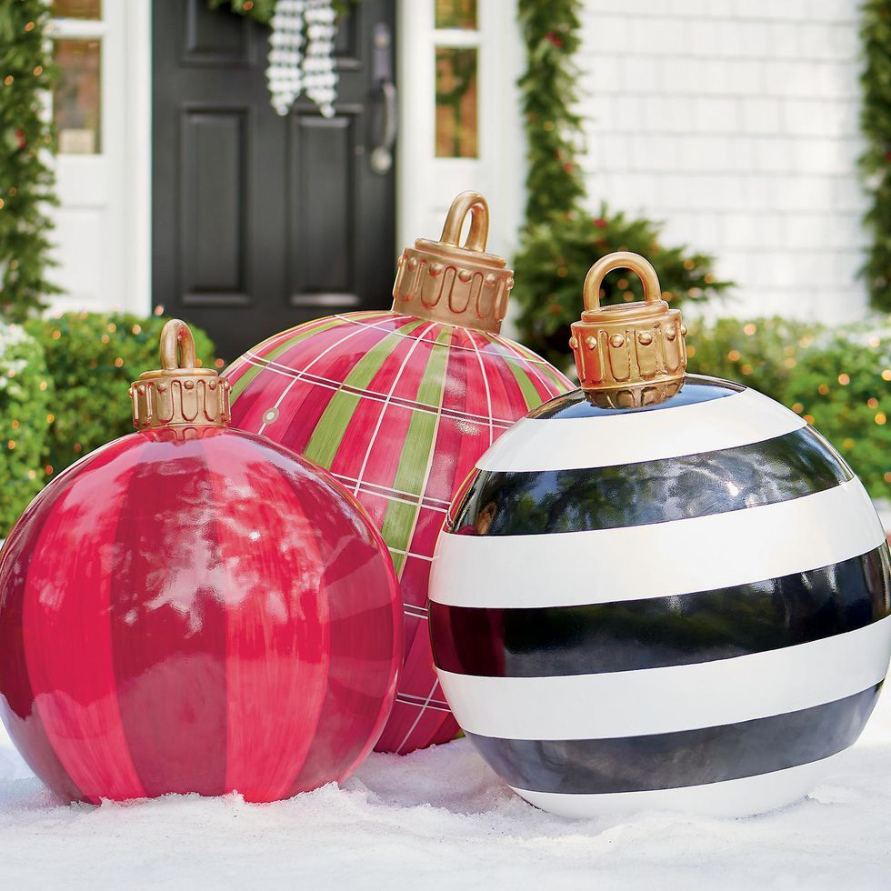 These Oversized Christmas Ornaments Are So Much Better Than Your Neighbor S Giant Inflatables Large Christmas Ornaments Outside Christmas Decorations Giant Christmas Ornaments