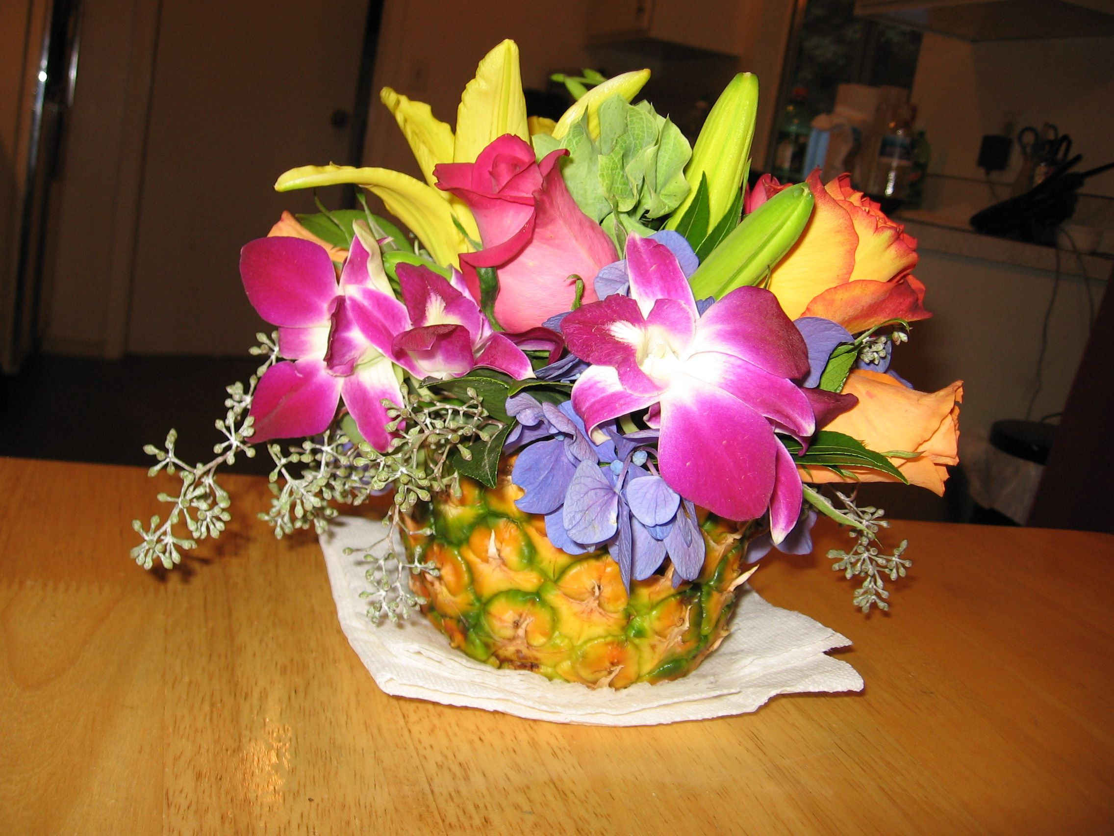 Flowers Pineapple Centerpiece For Hawaiian Themed Backyard Wedding