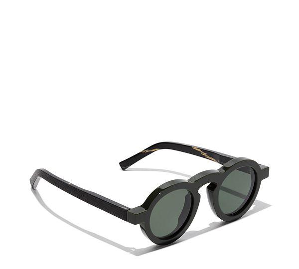 95ace32ec5 Gafas de acetato con montura redonda caracterizada por patillas con dibujo  de madera. Lentes con protección UV y anti-rayado.