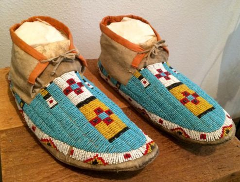 Sioux Moccasins  Circa 1910  Sinew Sewn   Hand Tanned Leather   Beads  FOB Dallas   Waterbird Traders Call for appointment.  Like us on Facebook: https://www.facebook.com/pages/Waterbir