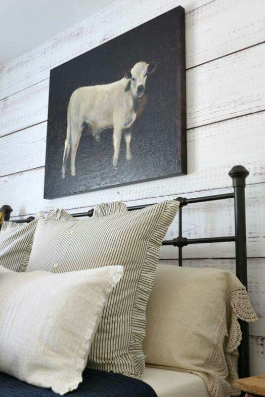 Love the pillows and shiplap, not the cow picture...