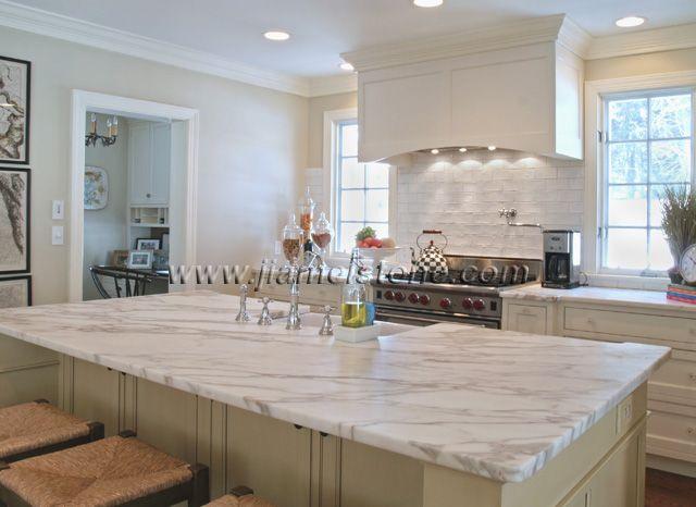 Elegant Kitchen Design With Carrara Marble Countertops White Color Brick Tile Backsplash And Stainless Steel Gas Range
