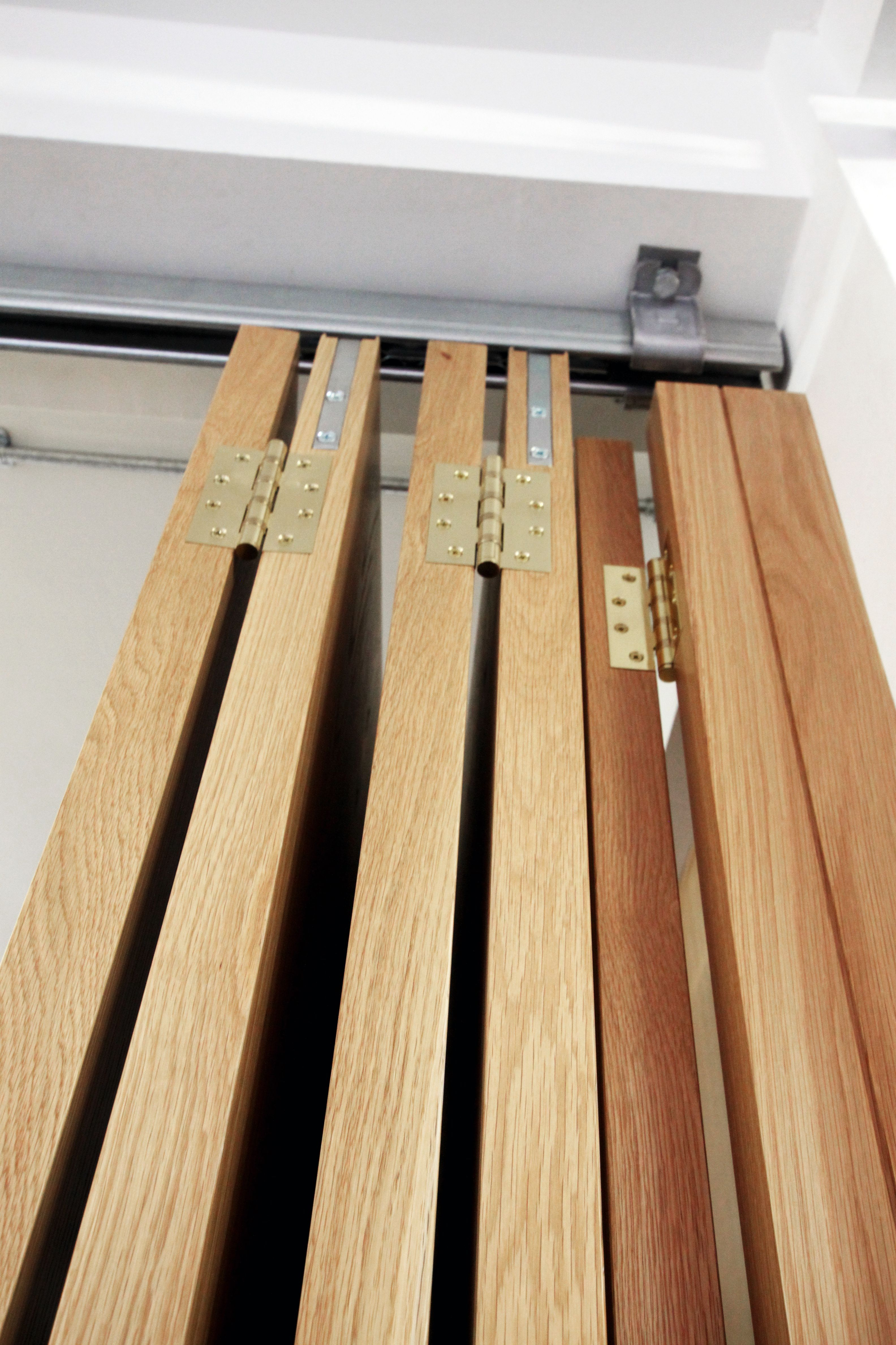 Main office floor-to-ceiling concertina sliding doors to sep…