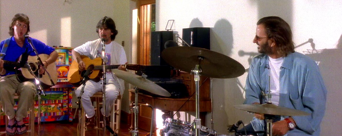 Paul, George and Ringo at Friar Park studio - with John Lennon's piano.