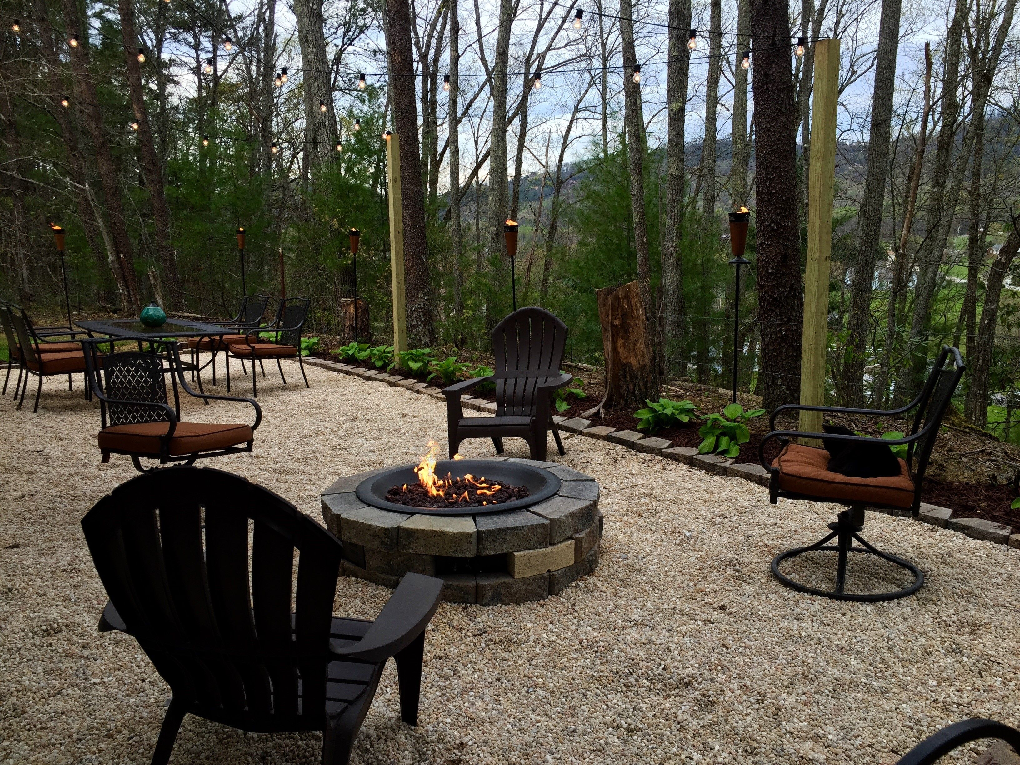 Our Patio ~ Pea gravel, Gas fire pit, cafe lights | Fire