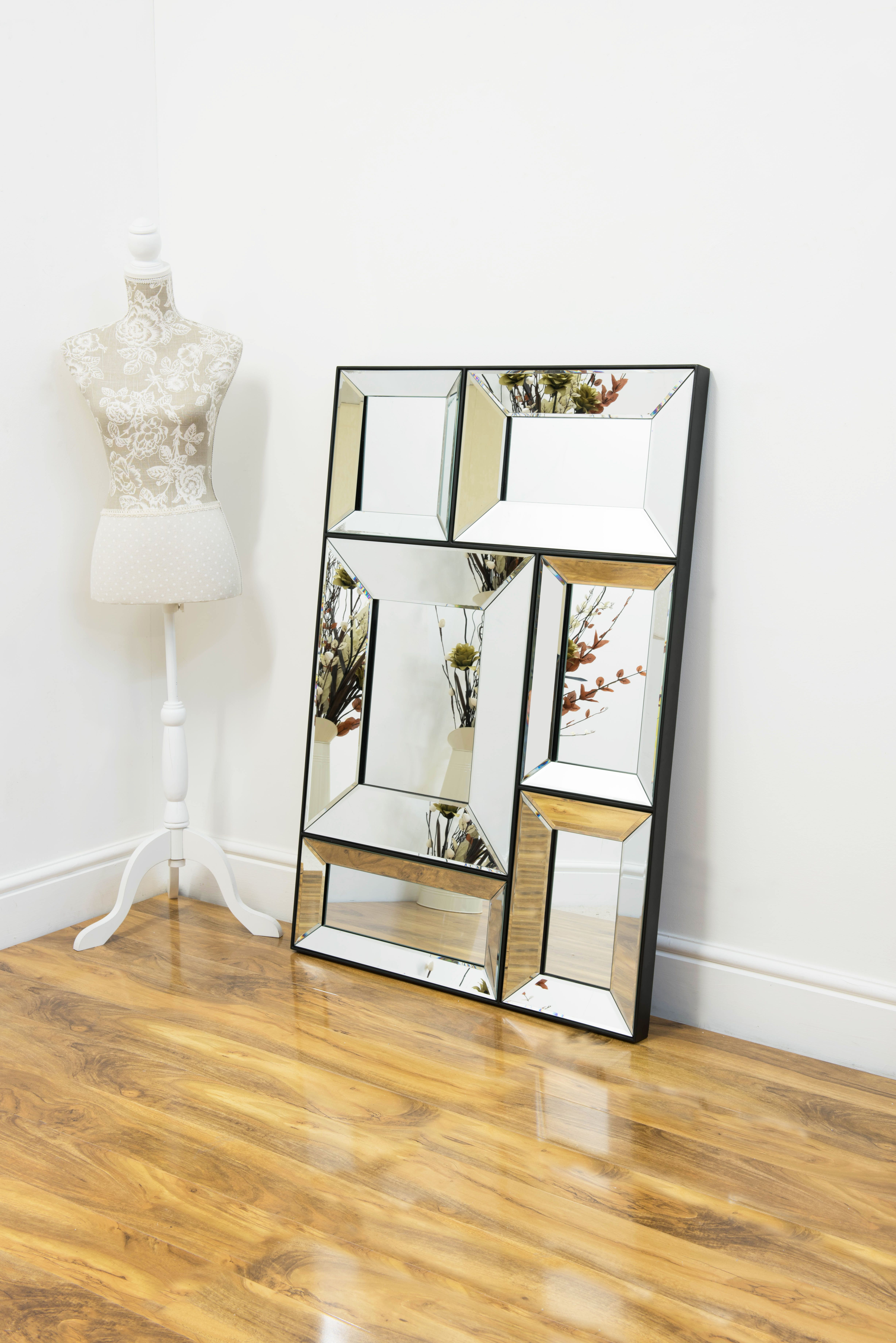 This mirror framed, chic, multi-mirrored frame will suit any ...