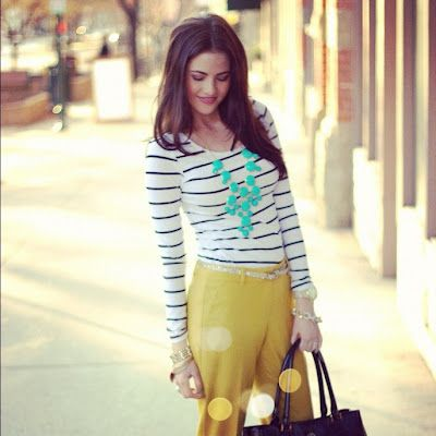 Love the pops of color on her, but I would never have the guts to wear yellow pants