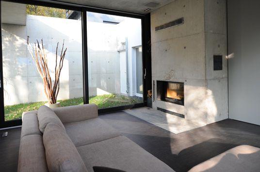 Neubau sichtbeton mauer kamin in beton modern sichtbeton - Betonwand wohnzimmer ...