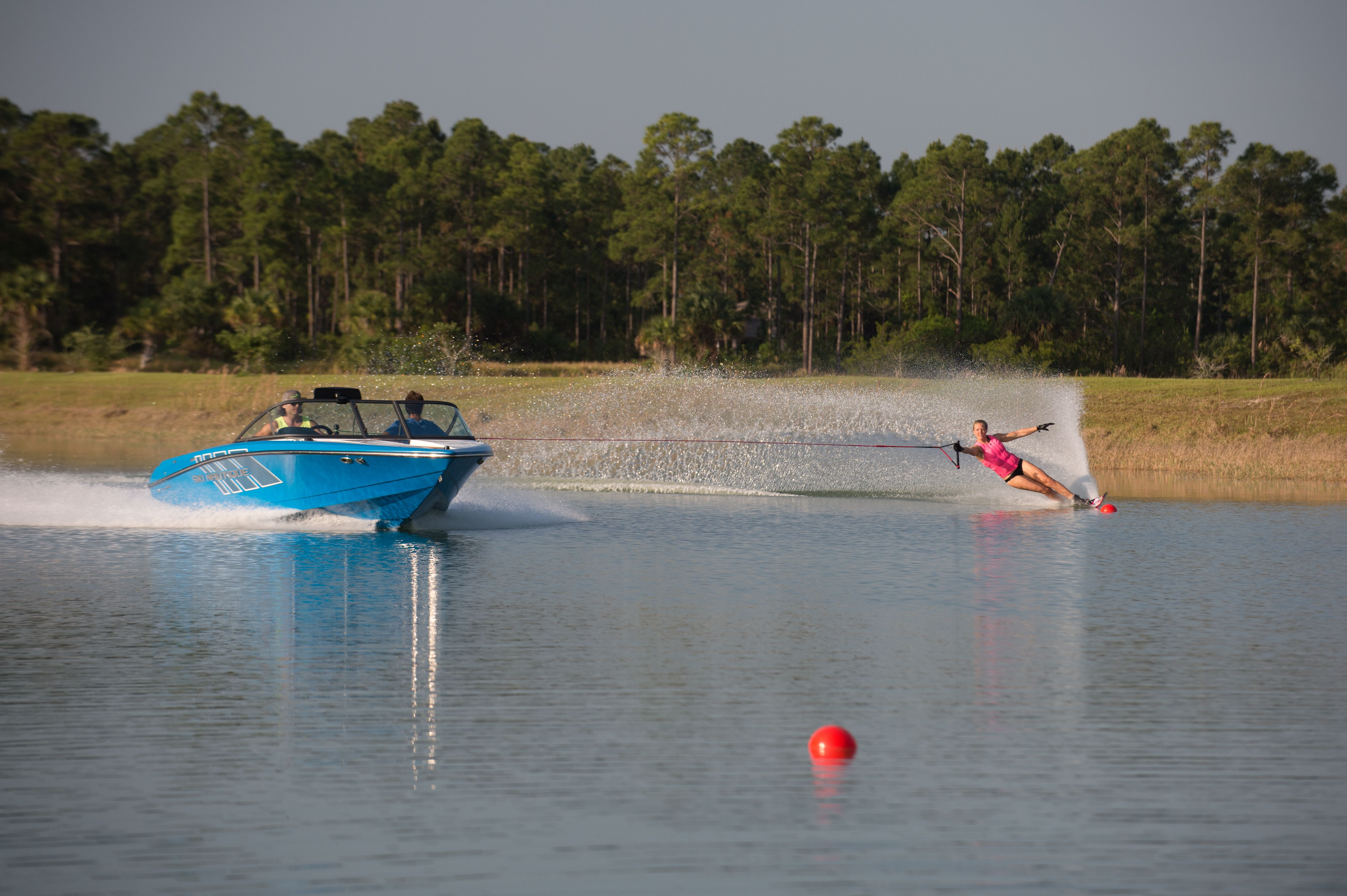 Waterskiing The Course Behind The 2018 Ski Nautique 200 Cb Water Skiing Wakeboard Boats Wakeboarding