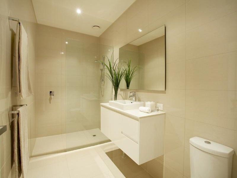 No bath and light colours work well in a small space.