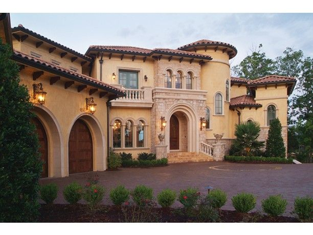 Curb appeal this stunning tuscan inspired home designed for Tuscan roof design