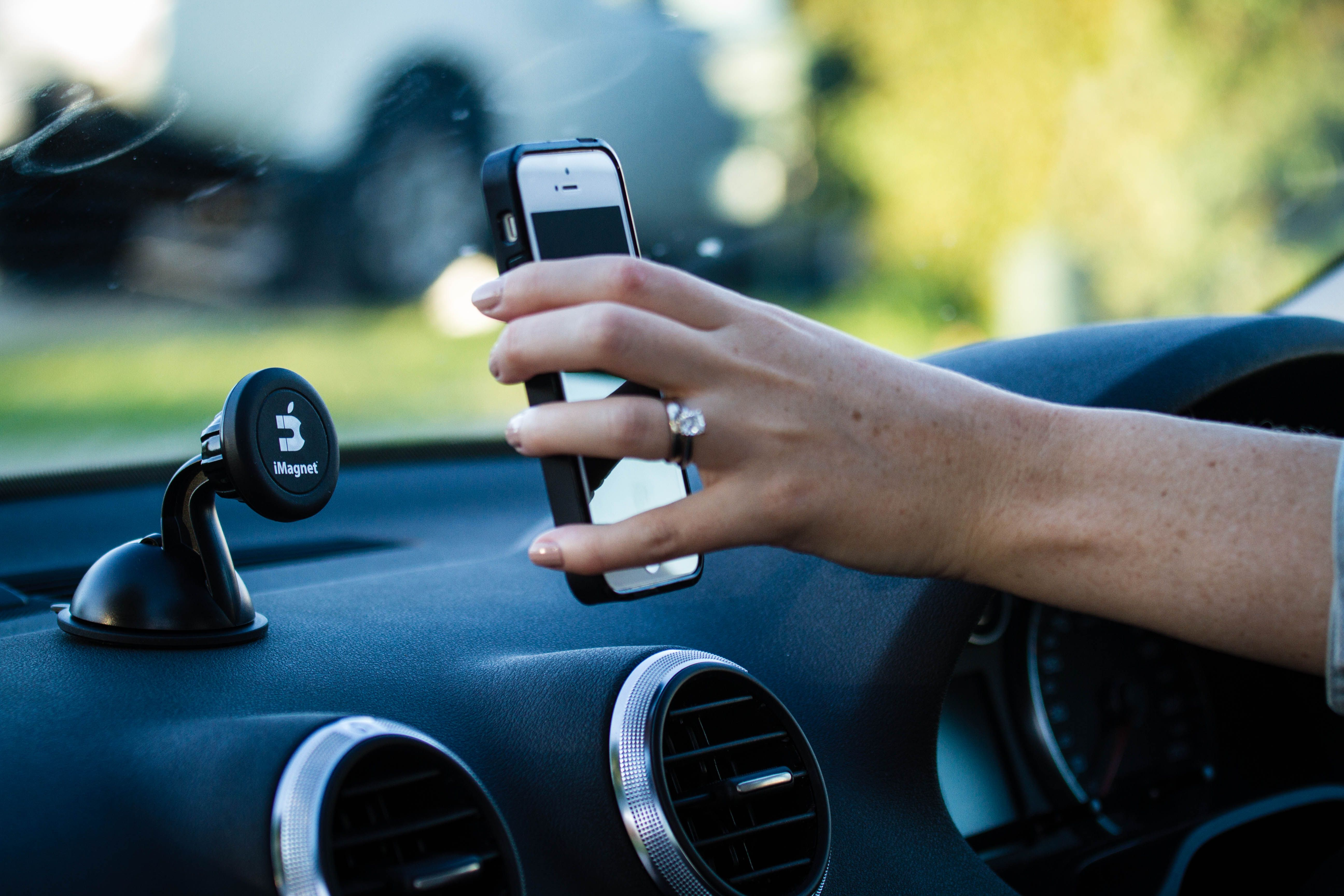 An IPhone About To Mount On IMagnet In An Audi A A Great Gift - Audi iphone 6 car mount
