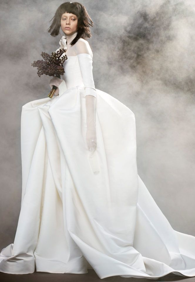 Light ivory plunging v-neck macramé lace gown with Chantilly lace bodice and appliquéd macramé lace scallop detailing on skirt