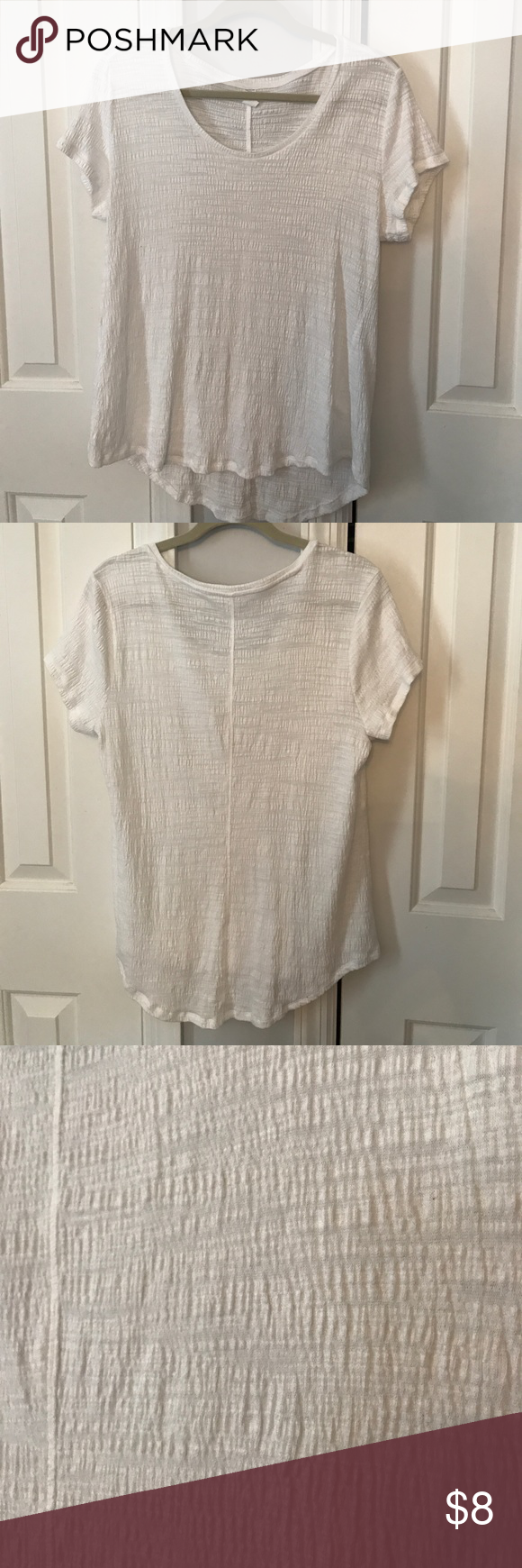 Vera Wang Simple White Shirt Washed once but never worn. A basic piece that can fit into any closet by Vera Wang! The material is textured (ridge like) Simply Vera Vera Wang Tops Tees - Short Sleeve