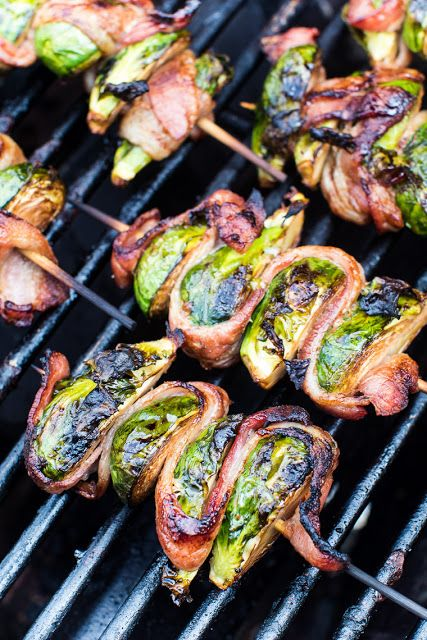 Delicious grilled Bacon Wrapped Brussel Sprouts on a skewer! This easy side dish is perfect for throwing on the grill and so tasty. A quick and simple balsamic marinade makes these the BEST Grilled Br #buffalobrusselsprouts