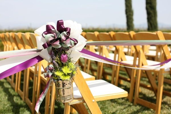 ... Chrome pail with mums, tulips, and lavender on ceremony chair ...