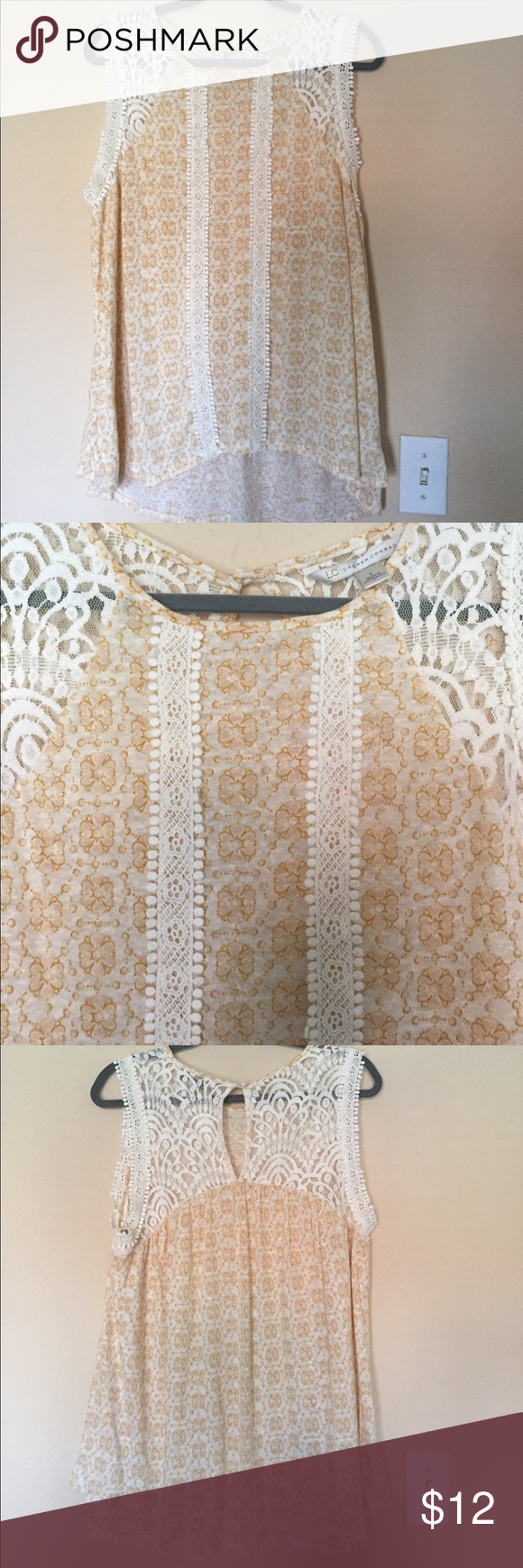 LC Lauren Conrad top with lace detailing. LC Lauren Conrad top with lace detailing. Cream with tan floral pattern. Lace detail on back too. Size L LC Lauren Conrad Tops Tunics