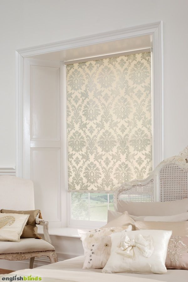 Luxury cream damask blinds in a white bedroom with a shabby chic