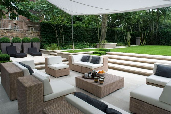 garden patio terrace lounge area with modular all weather weave chairs and sofas | Holland Park landscapeassociates