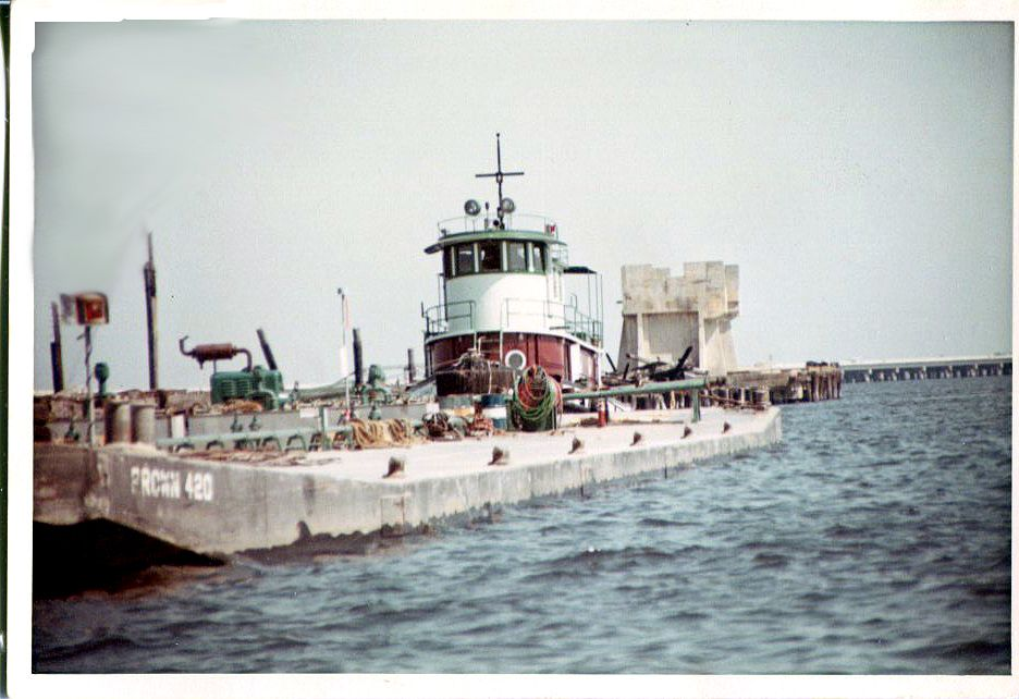 Tug Quarterhorse and barge Brown 420 (25,000 barrels). This photo would have been taked not too long before it sank in Wolf Bay, Alabama. This photo was taken while it was tied up at Muscogee Warf in Pensacola around 1968.