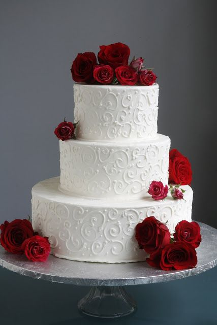 White Scrolled Wedding Cake With Red Roses Take The Cake