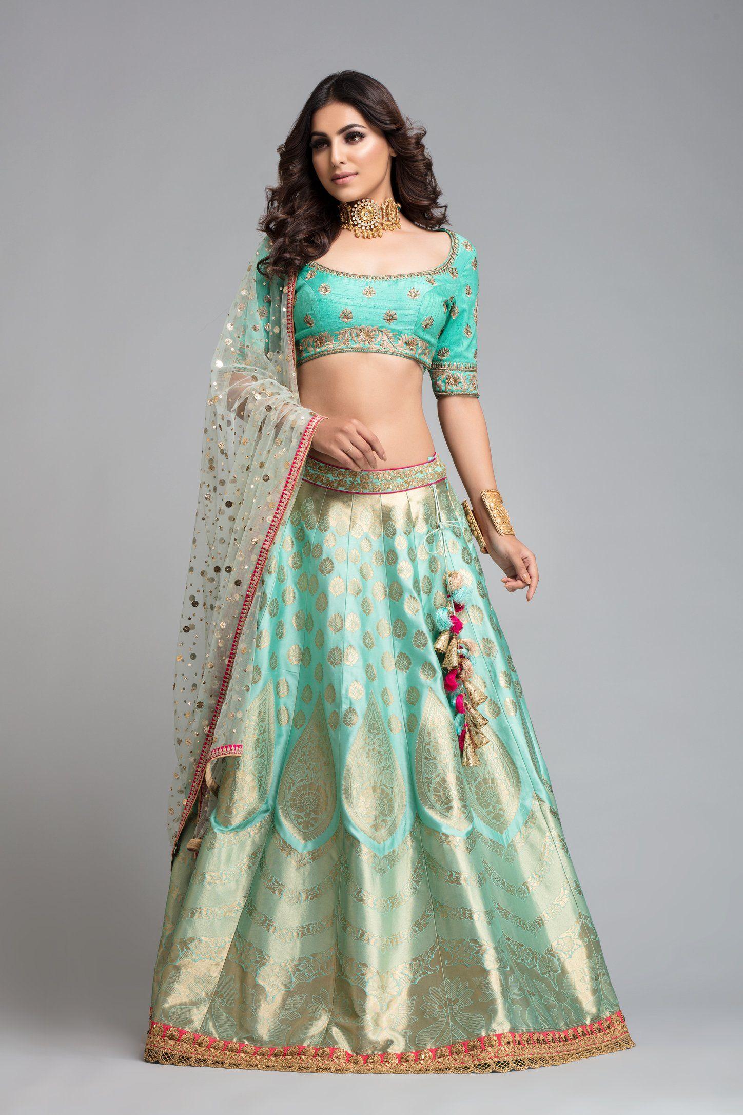 895c15fda4 Hand embroidered blouse with banarsi lehenga clubbed with mint mukaish  dupatta. Fabric: Raw Silk / Jacquard
