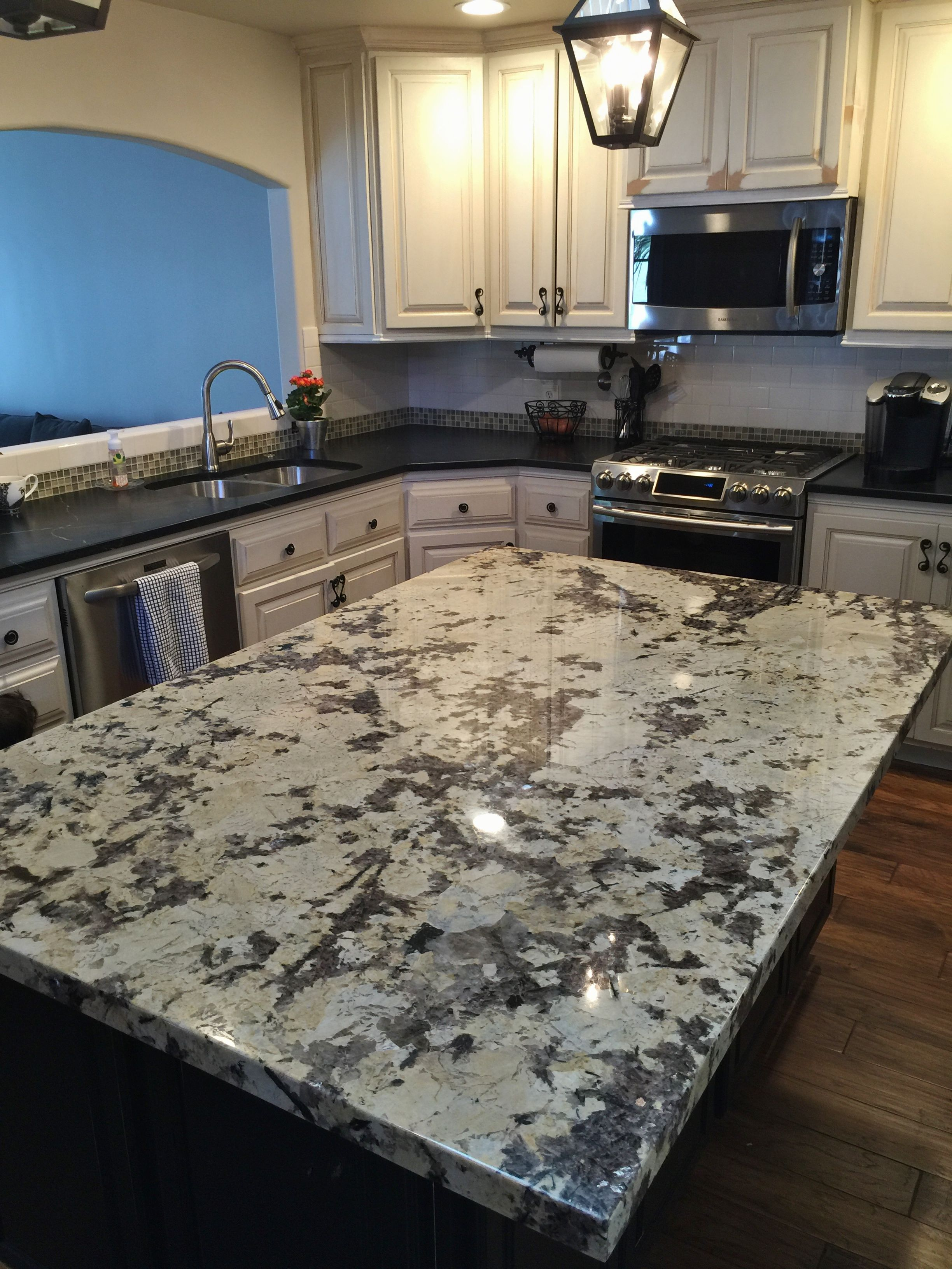 Granite Island Paired With Soapstone Countertops