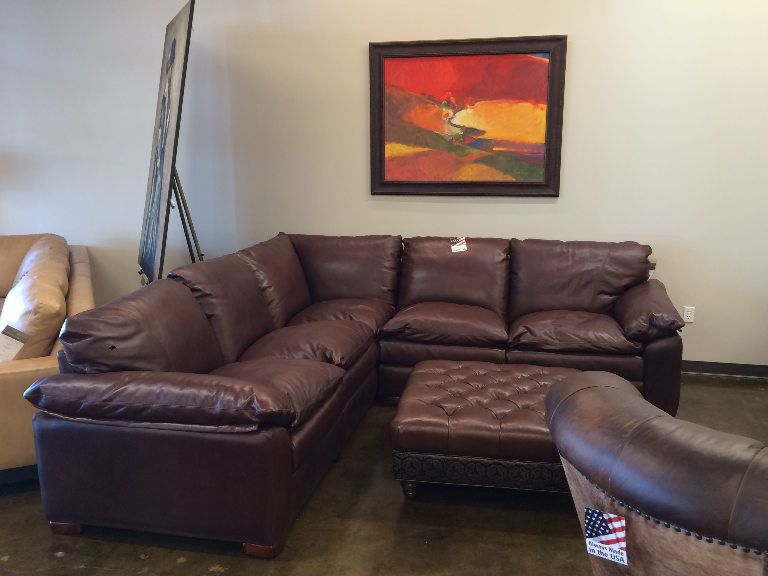 Leather Creations sectional and matching ottoman