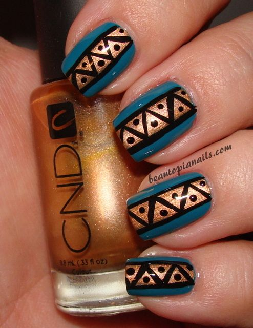 Glamorous, strong, striking and exquisite. These teal and bronze nails with black accents really make a statement!