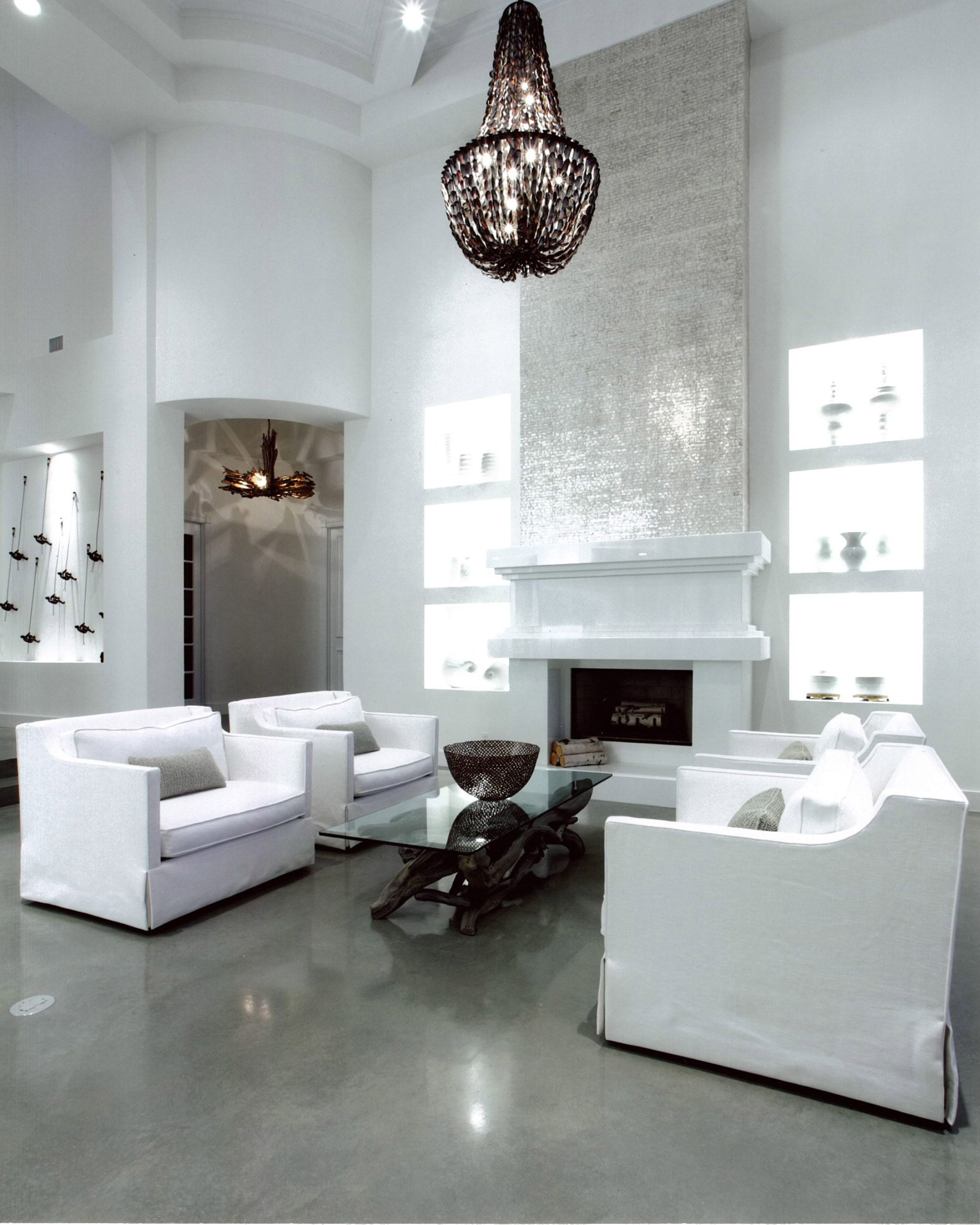 White Walls Contrast With Polished Grey Concrete Floors By Couture