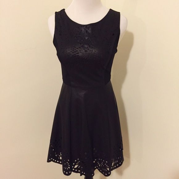 Laser Cut Pleather Skater Dress Super cute pleather dress with laser cut detailing.  Invisible zipper in back.  Back bodice is knit to allow more comfort and movement. Forever 21 Dresses Mini