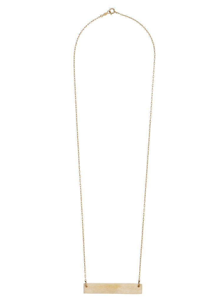 A simple bone bar necklace. Hand-carved in Haiti using cow bone and set on a gold chain. Available in Mini, Regularand Skinny-our longest and thinnest size...
