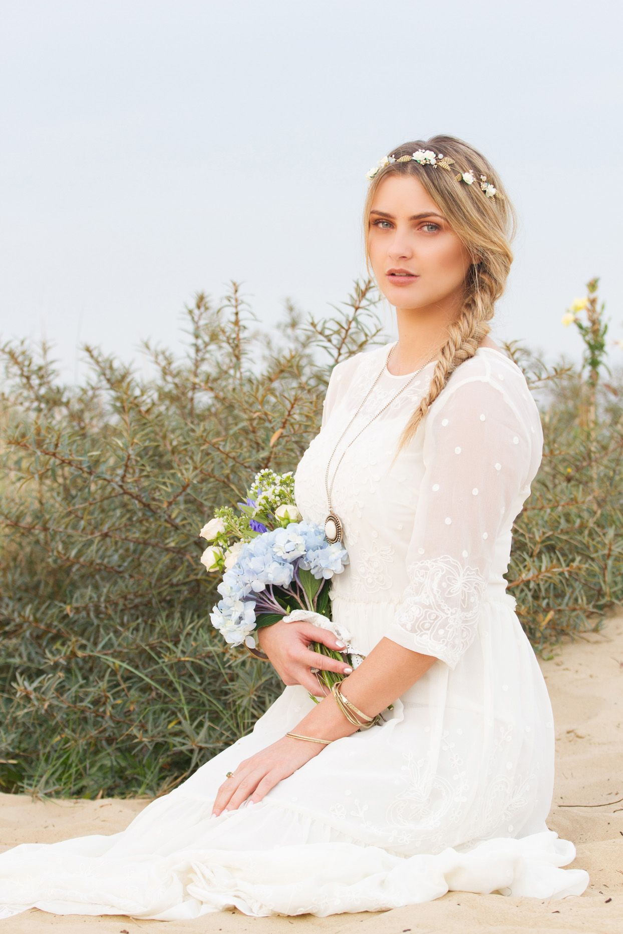 Beautiful blonde boho bride with fishtail plait and delicate flower ...
