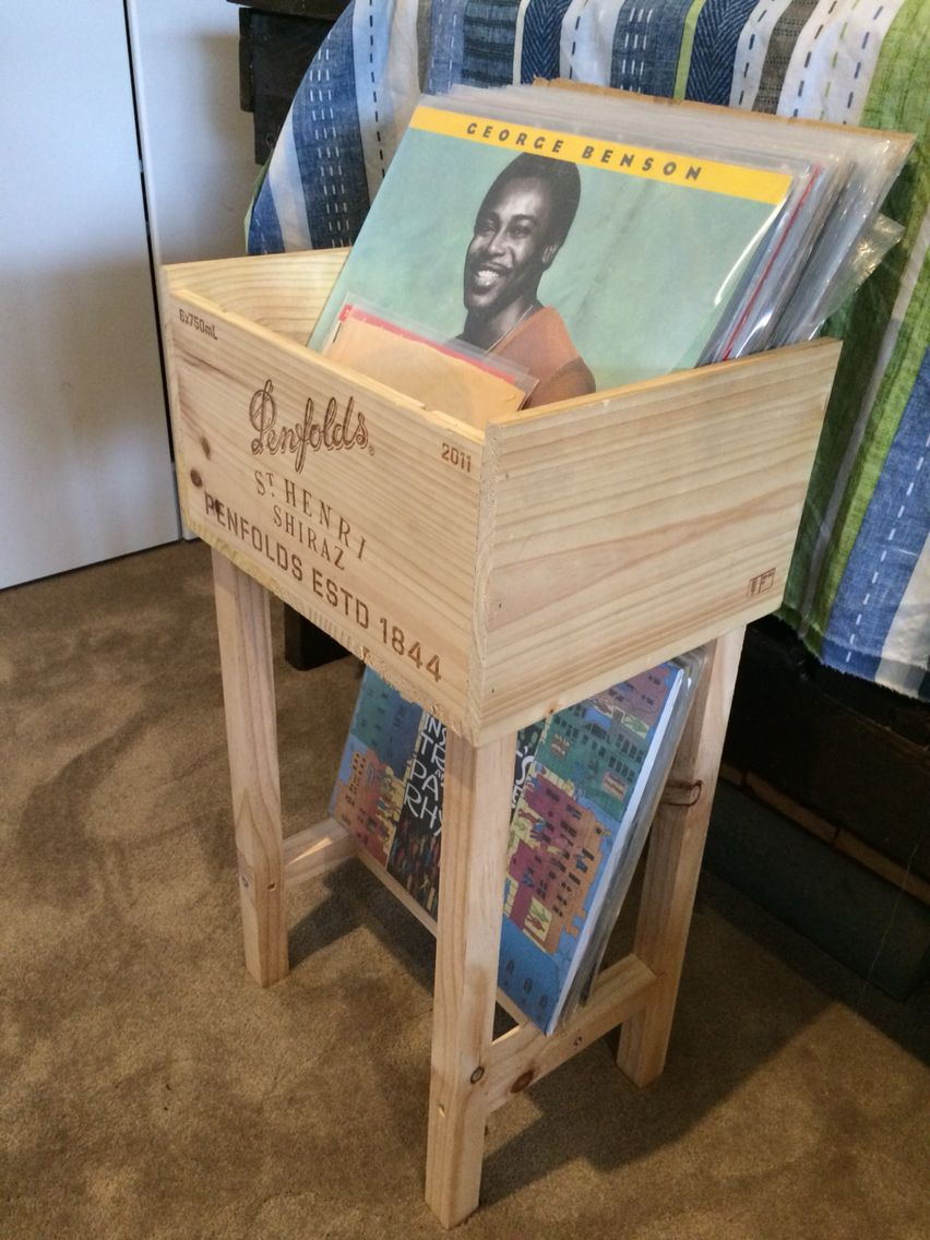 An old wine crate put on legs and now used as storage for