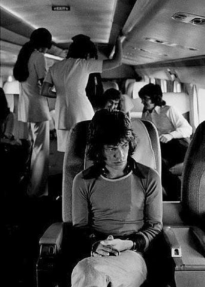 Mick Jagger - photo by Jim Marshall | rock n roll | the rolling stones | hot lips | shattered | tired | private jet | travel | vintage | music | on tour | black & white photography | iconic singer | exhausted | big night | hangover | icon | moves like jagger | www.republicofyou.com.au