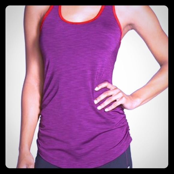 New Balance Workout Tank Super cute EUC running top from New Balance! Cover photo is not of actual top. Purple with dark pink stripes and trim. Great style in back! Shelf bra for support! New Balance Tops Tank Tops
