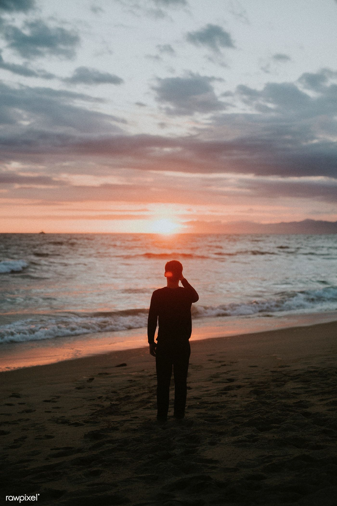 Download Premium Image Of Man Watching The Sunset On The Beach 1079875 Beach Photography Poses Beach Photography Sunset Photography