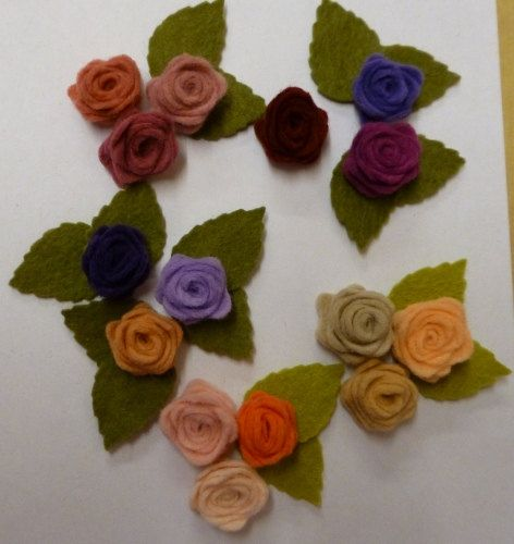 Vintage colours of felt roses by SusibeesButtons on Etsy, £8.00