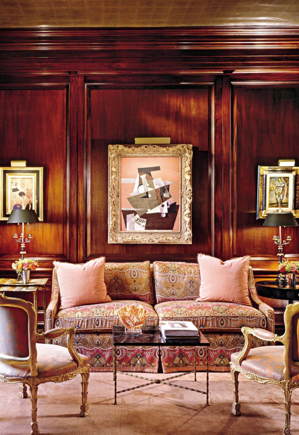 Traditional Office/Library by Hein + Cozzi /  In a Manhattan apartment, works by Joan Miró at left, and Georges Rouault flank Picasso's Guitare et Journal, which inspired the library's persimmon and peach fabrics and the custom-made silk carpet. The sofa is by Avery Boardman. /      Designer: Hein + Cozzi     Photographer: Durston Saylor     Homeowner: Loida Nicolas Lewis     Article: Vibrant Vision, January 2010     Location: New York, New York