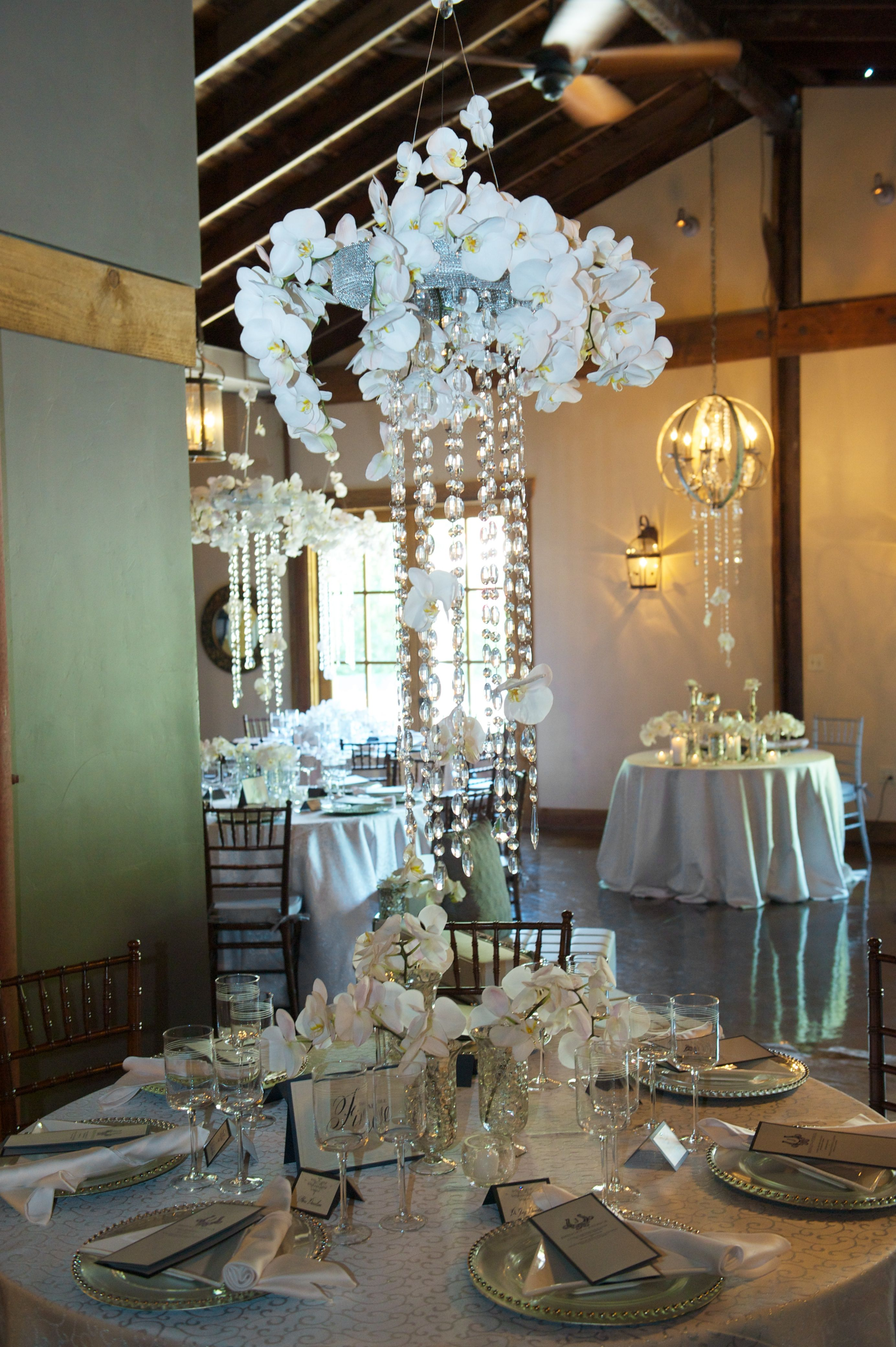 Elegant Floral Chandeliers Hang In The Red Horse Barn Florals By Visual Impact Design Photo By Sharpe W Garland Wedding Floral Chandelier Wedding Decorations