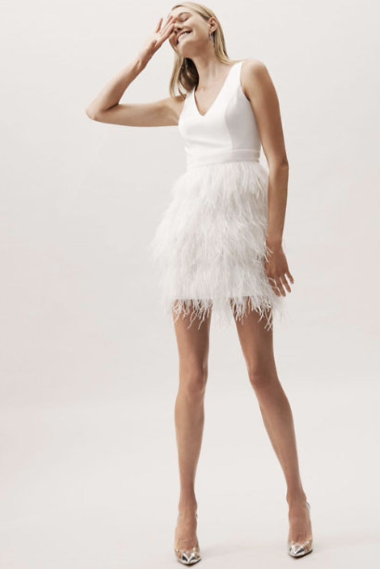Nontraditional Brides Will Love This Wedding Dress Trend Short Wedding Dress Wedding Dress With Feathers Column Wedding Dress [ 1166 x 778 Pixel ]