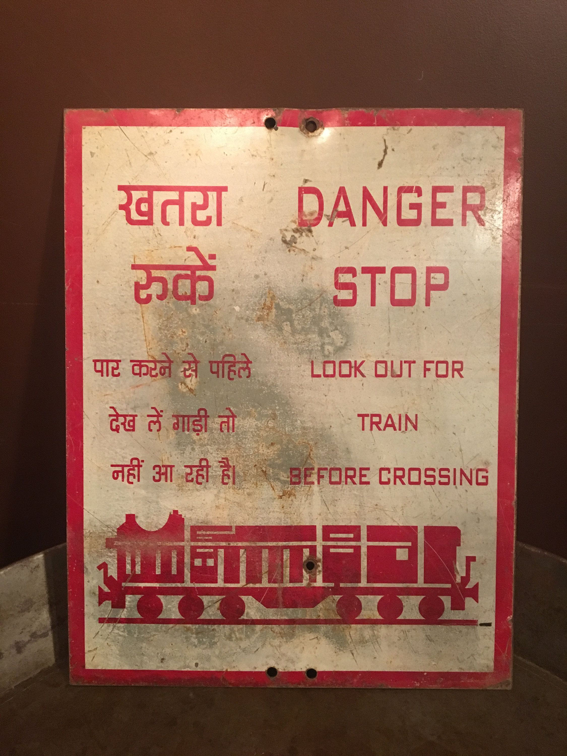 Vintage metal train crossing sign from india