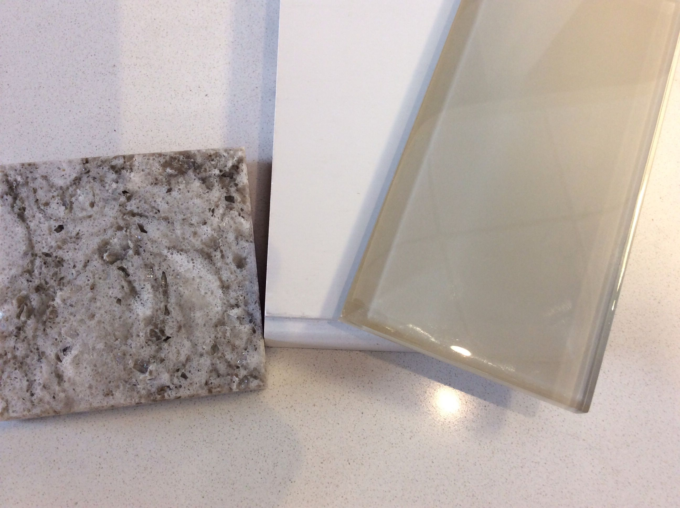 Taupe Quartz Countertop White Shaker Cabinet And Taupe Glass Subway Tile Samples