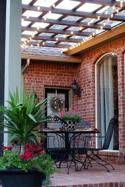 Unusual pergola attached to house. Love the little white strings of lights. #Dimples #Feature #Friday #Hospitality #Pergola #Pergola diy #Pergola modern #Pergola screen #Pergola wall #Southern #Tangles