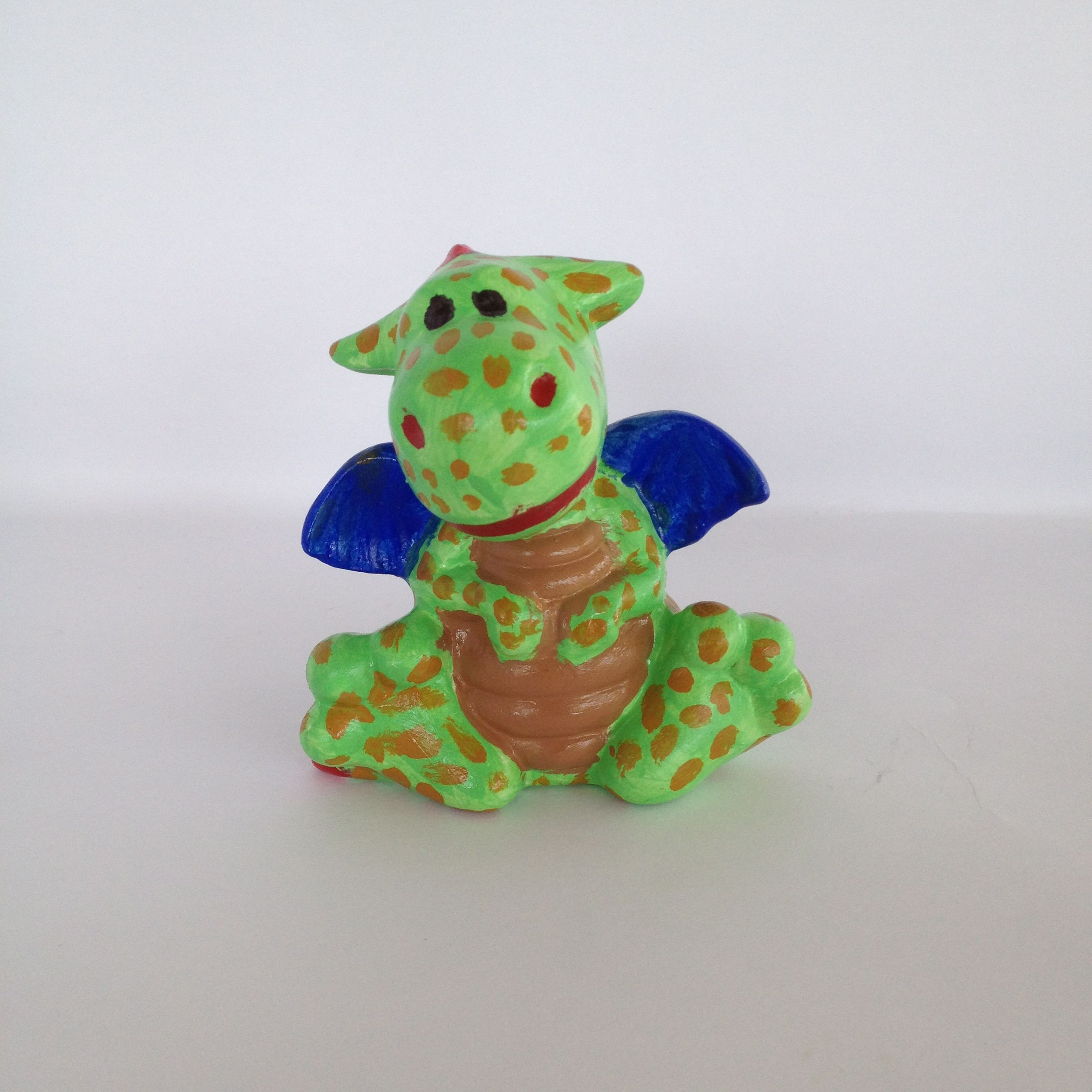 A cute little dotty dragon! Paint your own pottery