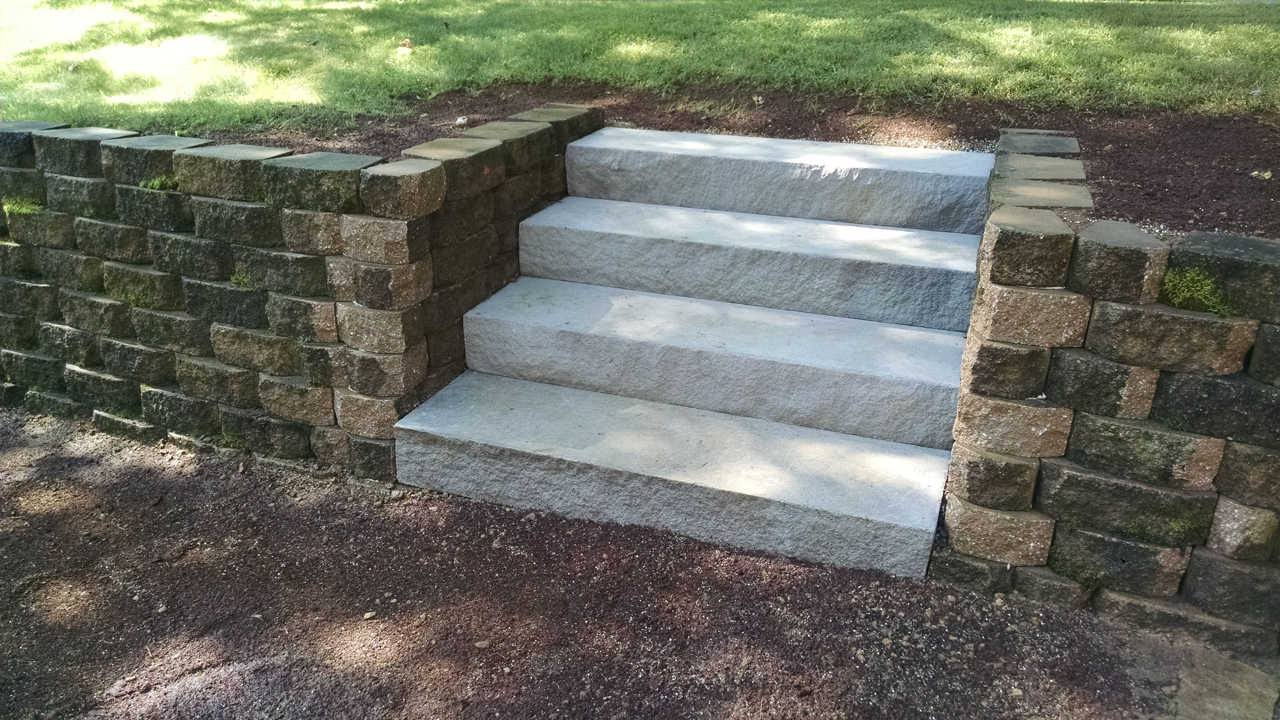 Natural Limestone steps in between existing wall.