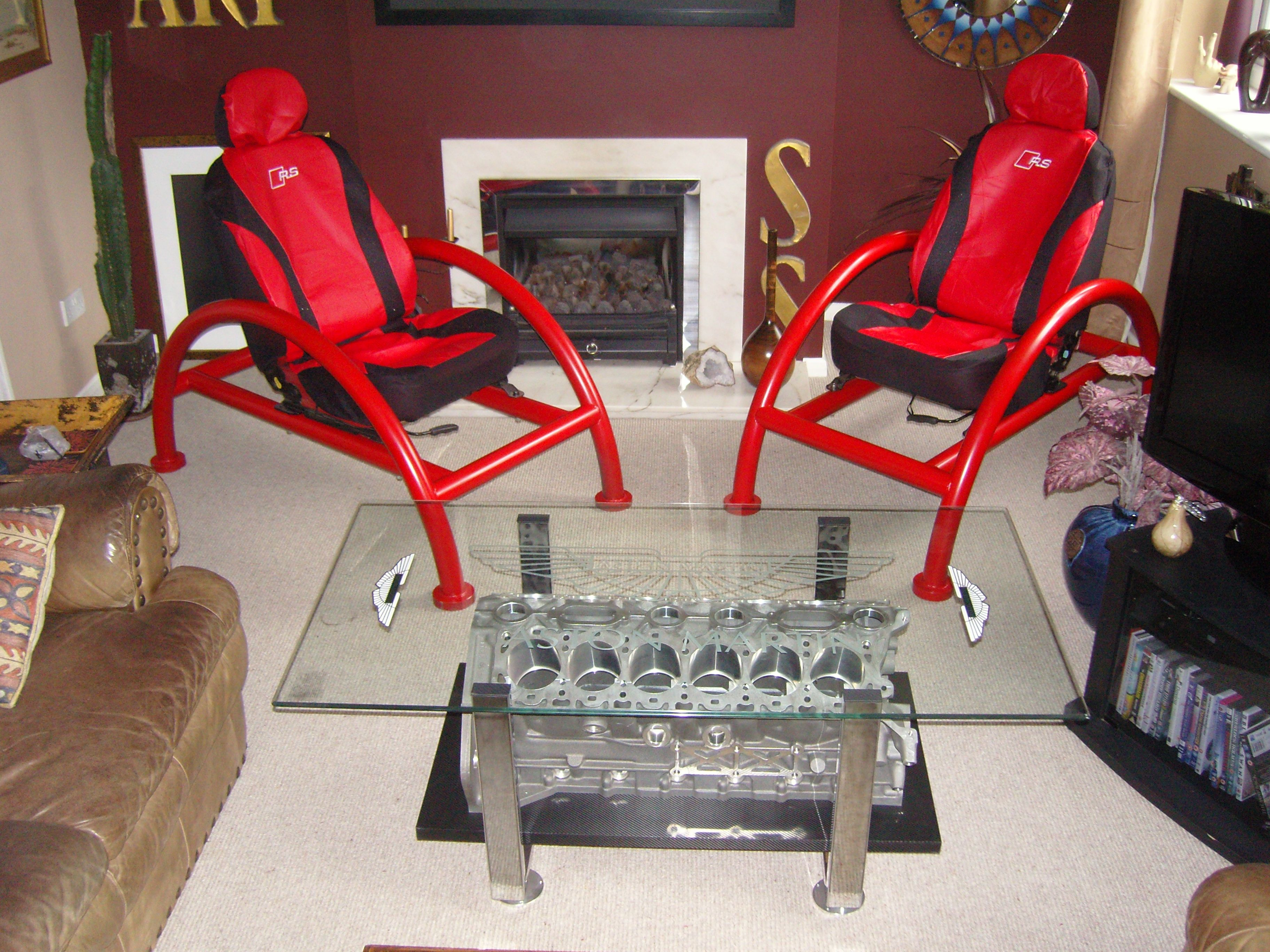 Custom built chairs and v12 aston martin engine block coffee table