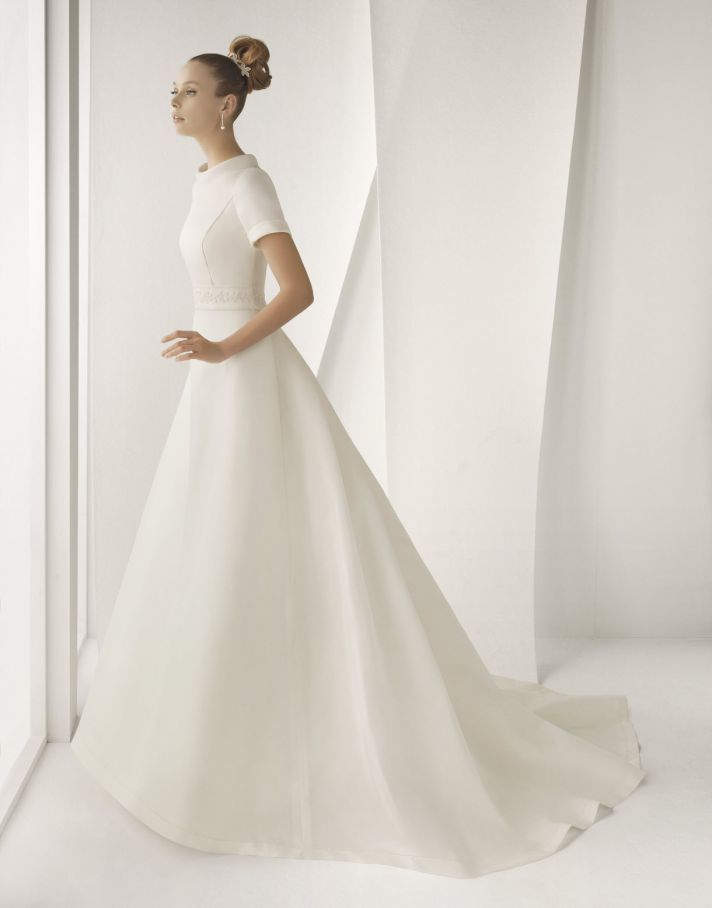 Modest ivory silk mikado Rosa Clara wedding dress with short sleeves and  high bateau neck You can find a lot of modest wedding dresses now a days i  love hoe ... d6dde461f50