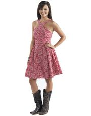 It is back! The R U Cowgirl Bandana Dress was the must have dress for 2012.  Redesigned with a one of a kind criss-cross neckline this dress features a natural waist line, back strap detail and back zipper closure.  Don't miss out of THE dress of 2013.